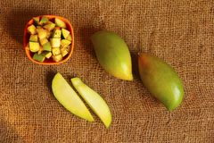 Raw totapuri mangoes, bowl full with sliced pieces applied with salt and chili powder Stock Photo