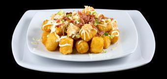 Totchos -Tater tots isolated on black background royalty free stock photos