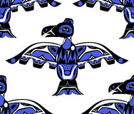 Totem bird indigenous art stylization. On with native ornament seamless pattern Stock Photos