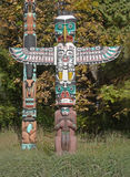 Totem. Definition, a natural object or an animate being, as an animal or bird, assumed as the emblem of a clan, family, or group Royalty Free Stock Photography