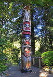 Totem. Definition, a natural object or an animate being, as an animal or bird, assumed as the emblem of a clan, family, or group Stock Photography