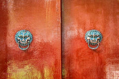 Totem on the door of Chinese traditional house. This is a old traditional house totem in Beijing, China. Has a over 4 hundreds years old history Royalty Free Stock Images
