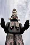 Totem Guarding the Spirits. At Namgis Burial Grounds overlooking Alert Bay, Vancouver Island, BC Stock Photo