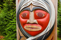 Totem head. A totem pole in Stanley Park. Vancouver, British Columbia, Canada Stock Image