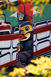 Totem mother. Figure, Canada.Framed by flowers Stock Photography