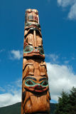 Totem Pole. On a blue sky in Alaska Stock Photo