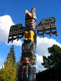 Totem Pole. With blue sky and white clouds in background Royalty Free Stock Photos