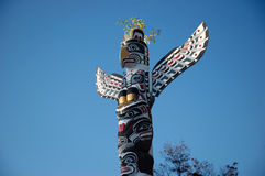 Totem Pole. A totem pole in blue sky background Royalty Free Stock Images
