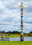 Totem Pole. Standing next to a lake with a cloudy sky Stock Photography
