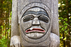 Totem Pole. Close-up of Native American Wooden Totem Pole Carving Stock Photos