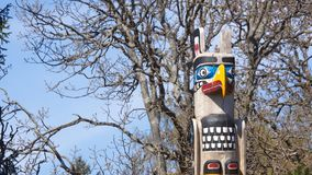 Totem pole by ancient native indian americans in the Government Royalty Free Stock Photo