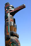 Totem pole and blue sky Royalty Free Stock Image