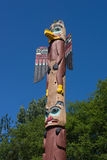 Alaskan Totem Pole. Storytelling Totem Pole by local Inuit carving masters. This one is located in Ketchikan, Alaska Stock Photos