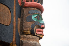 Totem pole carving in Duncan British Columbia Canada. A colorful wooden totem pole at Duncan British Columbia Canada Stock Image