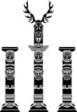 Totem pole with a deer skull Stock Images