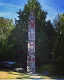 Totem pole on display behind The Museum of Anthropology in Vancouver, British C. Totem pole on display behind The Museum of Anthropology at the University of Stock Photo