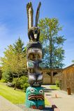 Totem pole with eagle on top, totem pole of canadian indians Royalty Free Stock Photos