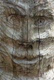 Totem pole face. Wooden totem pole detail: face Stock Images