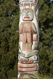 Totem pole figures Vancouver stock photo