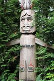 Totem pole in forest Royalty Free Stock Photos