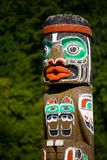 Totem pole in the forest royalty free stock photos