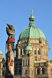 Totem Pole In Front of B.C. Legislature Building Royalty Free Stock Images