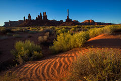 Totem pole and sand dunes in Monument Valley Royalty Free Stock Photography