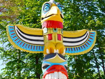 Totem pole. Sculpture Totem Pole Eagle wings Royalty Free Stock Image