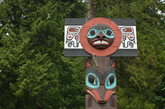 Totem pole in Vancouver garden Royalty Free Stock Photos
