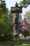 Totem Pole. VICTORIA,BC CANADA SEPTEMBER 1,2013: Totem poles in Thunderbird park carved by indigenous Canadians. The park is part of the Royal BC Museums Stock Photography