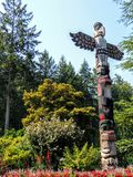 Totem Pole Victoria Canada. VICTORIA,BC CANADA Totem pole carved by indigenous Canadians Stock Images