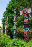 Totem poles. Lively historic totem poles by ancient native indian americans in the stanley park, Vancouver, British Columbia, Canada Royalty Free Stock Photos