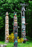Totem poles. Lively historic totem poles by ancient native indian americans in the stanley park, Vancouver, British Columbia, Canada Stock Photos