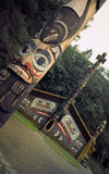 Totem Poles and Clan House Stock Photo
