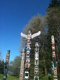 Totem poles. Native American art at its finest in Vancouver, Canada Stock Image