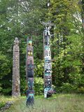 Totem poles in Staley Park in Vancouver, Canada Royalty Free Stock Images