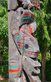 The Totem Poles. VANCOUVER BC CANADA JUNE 09 2015: The Totem Poles at Brockton Point in Stanley Park are one of the most visited tourist attractions. Carvings Royalty Free Stock Image