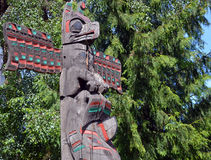 The Totem Poles. VANCOUVER BC CANADA JUNE 09 2015: The Totem Poles at Brockton Point in Stanley Park are one of the most visited tourist attractions. Carvings Stock Photos