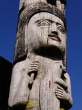 Totem Symbols. Alaskan native totem pole with symbolic female and seal carvings stock photos