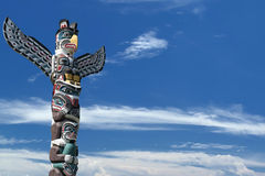 Totem wood pole in the blue cloudy background royalty free stock photos