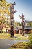 Totempfähle in Victoria BC Stockfoto