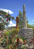 Totems and more objects at an equatorial park Stock Photo