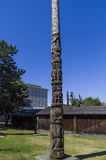 Totems. VICTORIA,BC CANADA SEPTEMBER 1,2013: Totem poles in Thunderbird park carved by indigenous Canadians. The park is part of the Royal BC Museums Royalty Free Stock Image