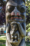 Totems. VICTORIA,BC CANADA SEPTEMBER 1,2013: Totem poles in Thunderbird park carved by indigenous Canadians. The park is part of the Royal BC Museums Stock Image