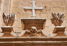 The Totenkopf  as decorative element over the entrance to the re. The Totenkopf, skull and crossbones, a dead`s head symbol,  as a decorative element over the Stock Photography