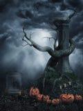 Toter Baum mit Kürbisen