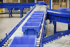 Totes on a Conveyor Belt. Totes move on a automated conveyor system royalty free stock image