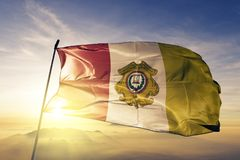 Totonicapan Department of Guatemala flag textile cloth fabric waving on the top sunrise mist fog. Beautiful royalty free stock photos
