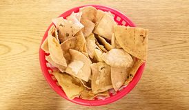 Close-up of totopos, hard tortilla or tortilla chips, traditional Mexican food. Totopos, hard tortilla chips, typical traditional Mexican food to dip in salsa stock image