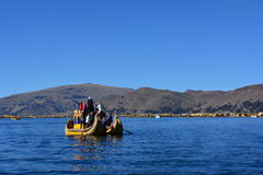 A Totora boat floating on the Titicaca lake, in Peru Royalty Free Stock Images